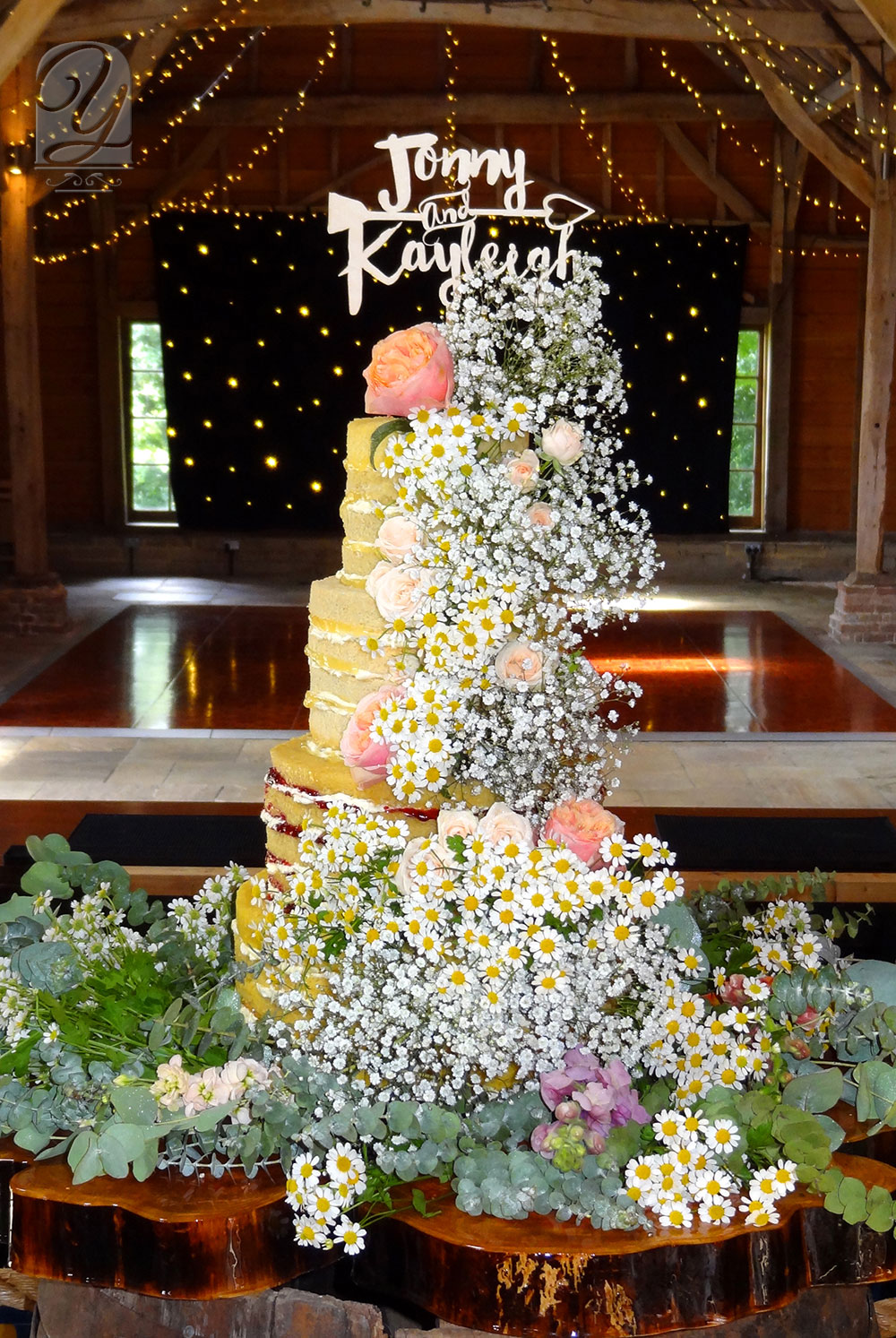 The Boho Naked Cake with Summer Flowers from Unique Cakes by Yevnig is a moreish selection of premium naked sponge cakes adorned with beautiful summertime flowers