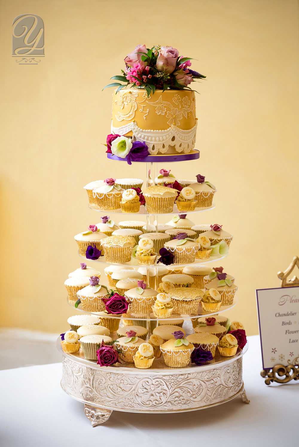 Unusual cupcake golden tower with luxurious shimmered top tier wedding cake from Unique Cakes by Yevnig