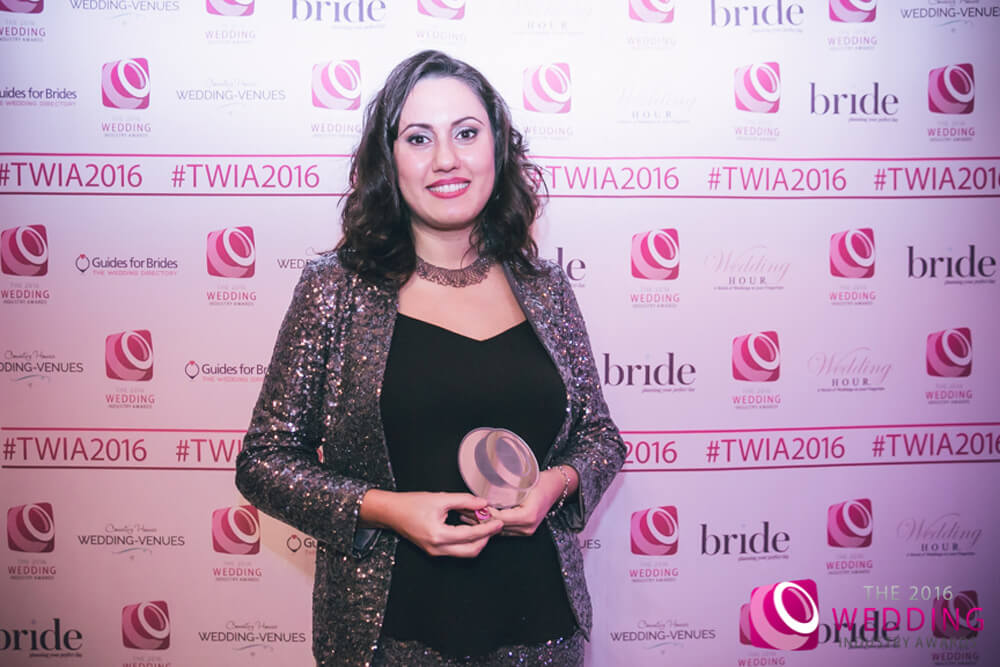 Yevnig Davis of Unique Cakes, by Yevnig Best Cake Designer for London and the South East at The Wedding Industry Awards 2016. Luxury bespoke wedding cakes